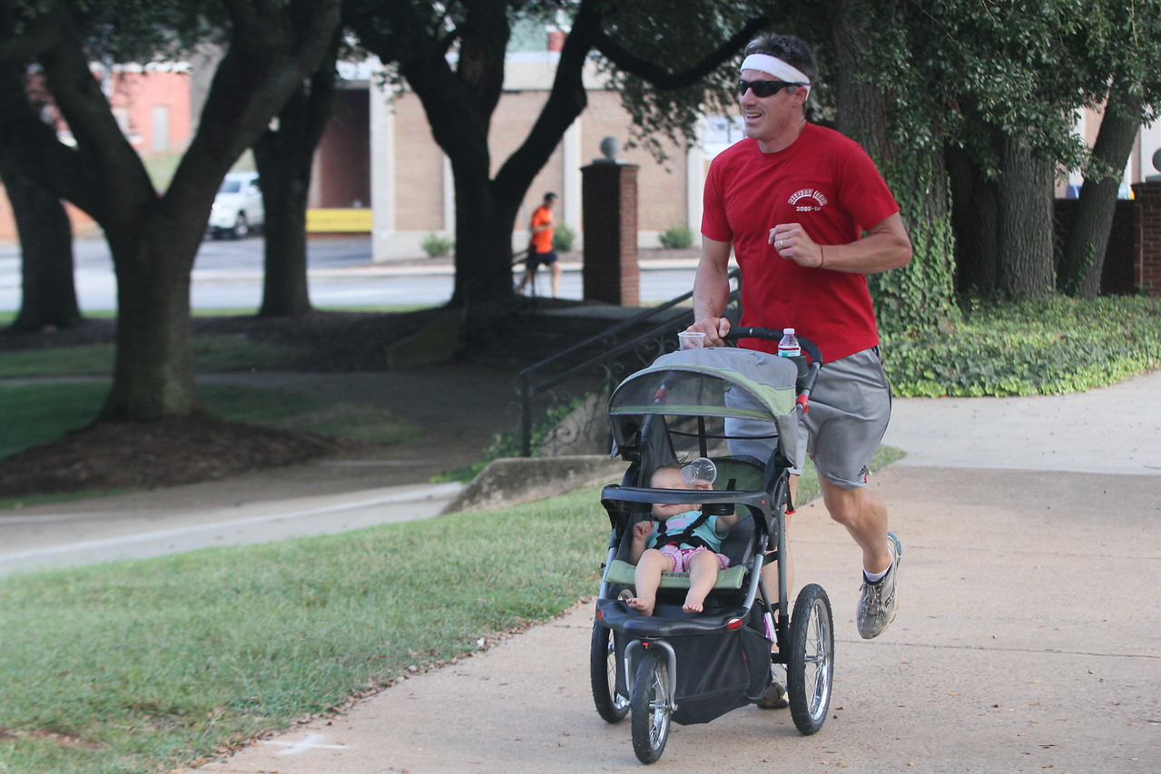 Daddy and daughter racing to the finish