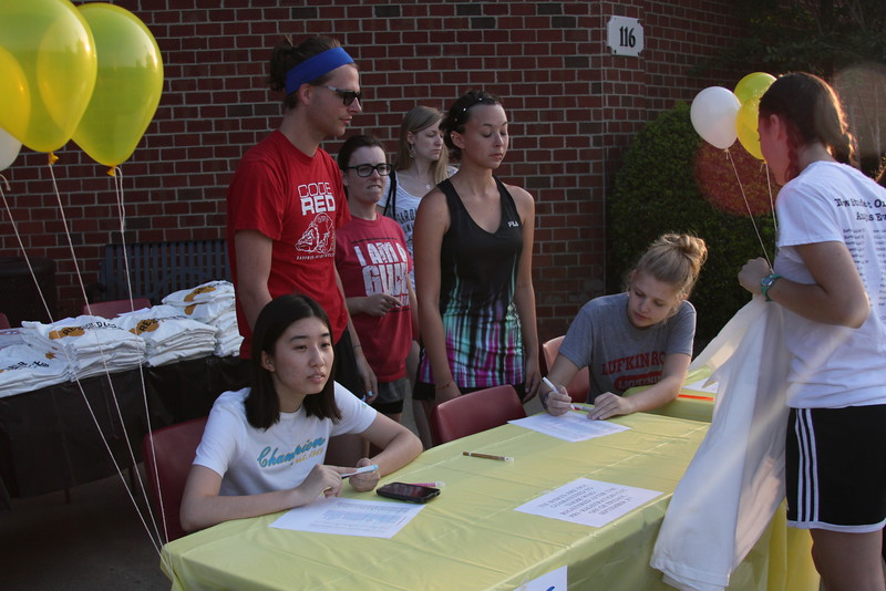 Students checking in and receiving their T-Shirts for the race