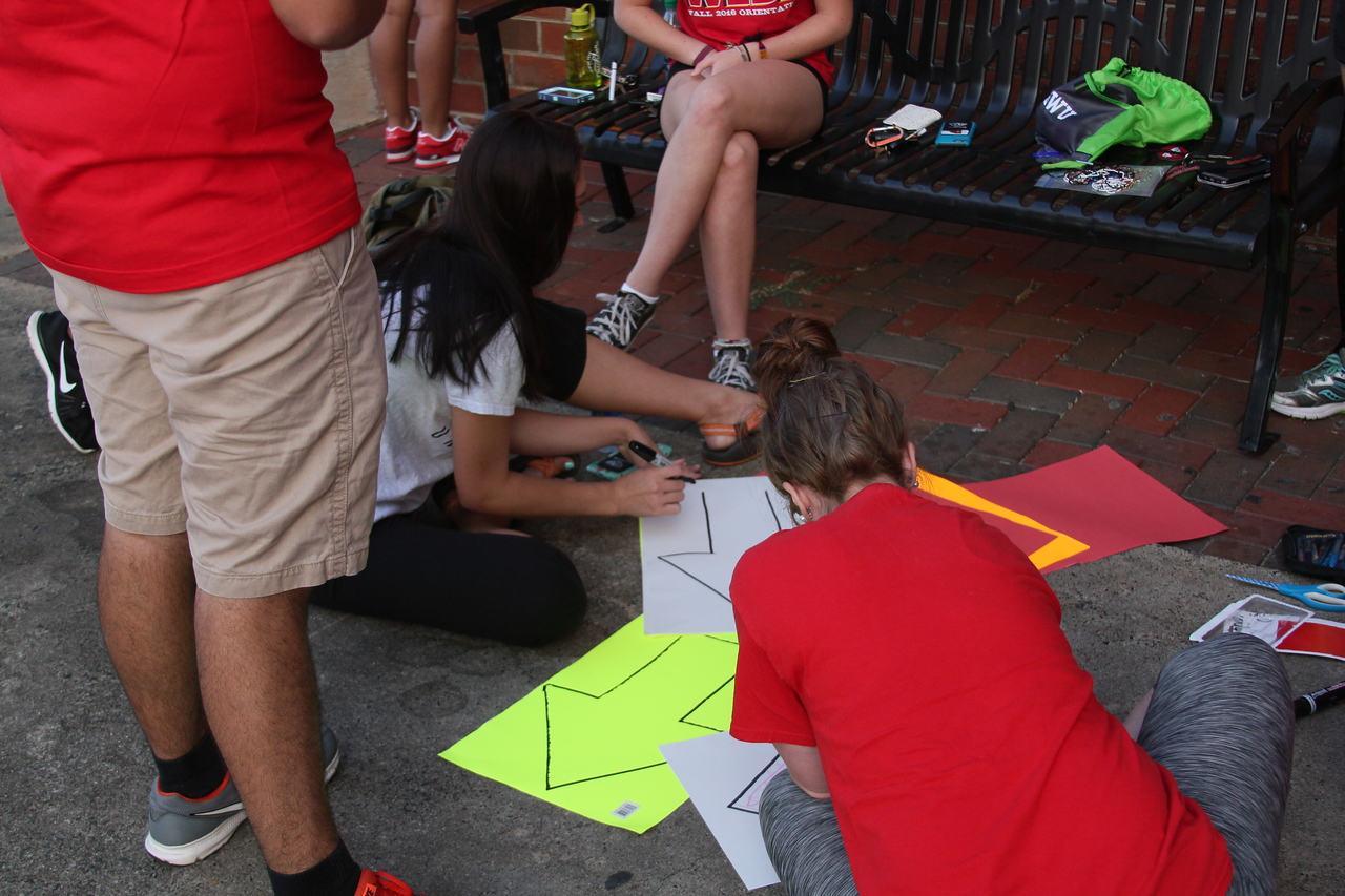 Students making posters to map out the race