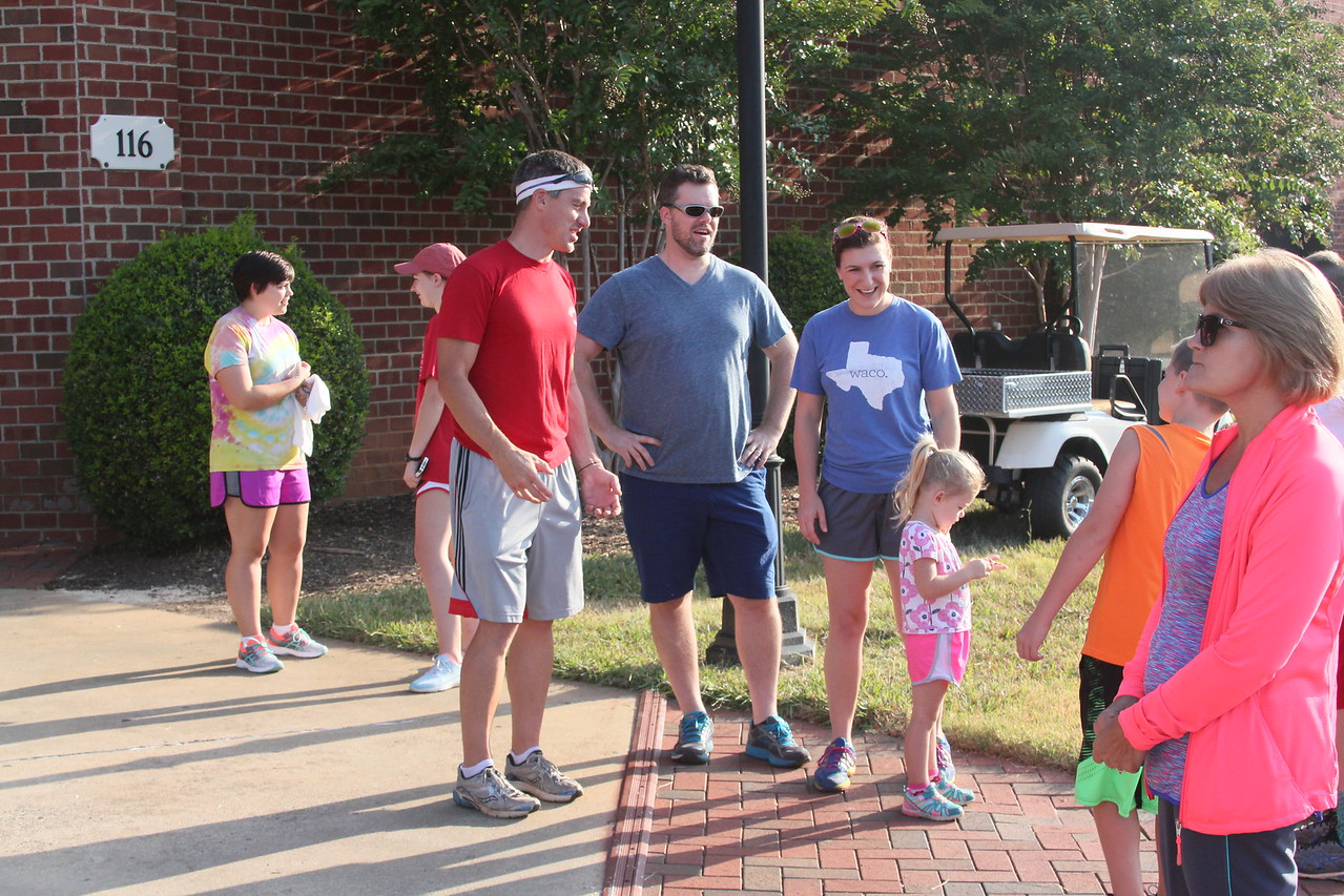 Families and friends mingle as the race draws closer
