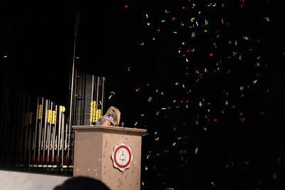 Bridgette Turner shoots off a confetti cannon to end her speech