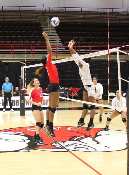 Keira Moore (7) goes up against A&T's outside hitter