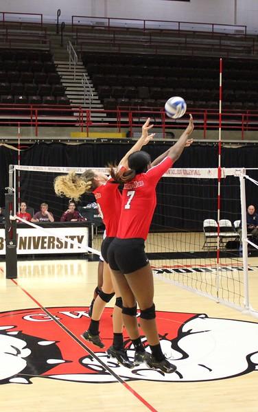 Keira Moore (7) and Hannah Driscoll blocking