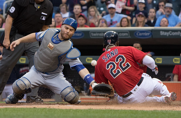 Minnesota Twins right fielder Miguel Sano (22) slides safetly to home after Minnesota Twins center fielder Robbie Grossman (36) singles in his first major league at bat in the third of a four game series between the Minnesota Twins and Toronto Blue Jays May 20, 2016 at Target Field in Minneapolis, Minn. Photo credit: Matt Blewett/The Minnesota Sports Report.