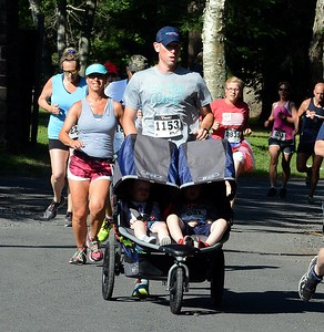 Bensalem's Eric Frank (#1153) makes the Revolutionary Run a true family affair in running event that takes place every year on the Fourth of July in Washington's Crossing. (John Gleeson – 21st-Century Media)