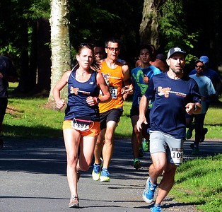Holland's Allyson Thompson (#1492), left, was the first female finisher inb the 10K road race.