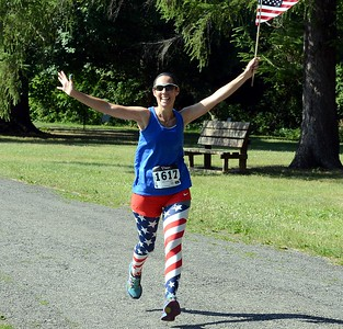 Jessica Glover shows her patriotic spirit as she nears the finish line.