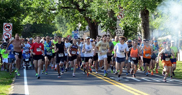 The 10K road race begins the 36th annual Revolutionary Run, a 5 and 10K running event that takes place every year on the Fourth of July in Washington's Crossing. (John Gleeson – 21st-Century Media)