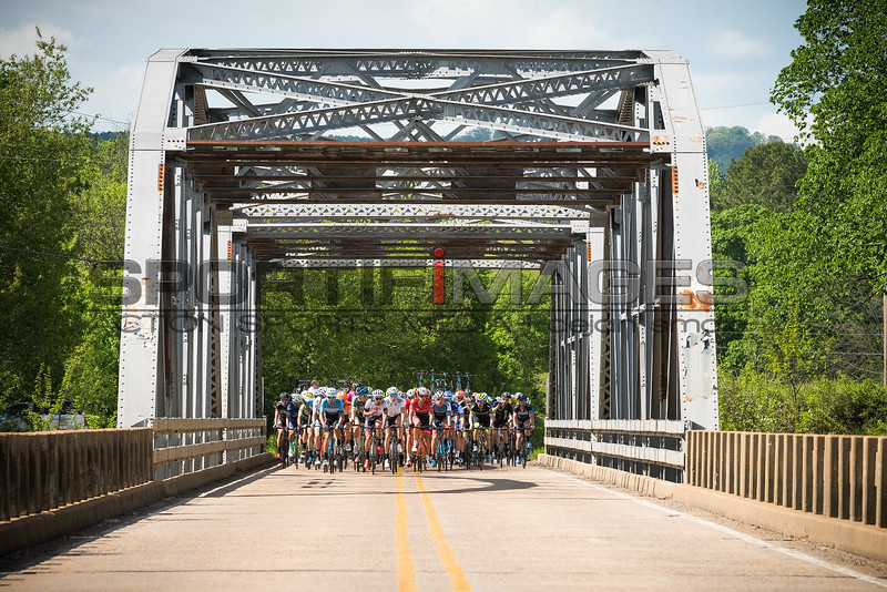 Joe Martin Stage Race Stage 2. UCI Pro 1 Men.  The field rolls across a steel truss bridge.