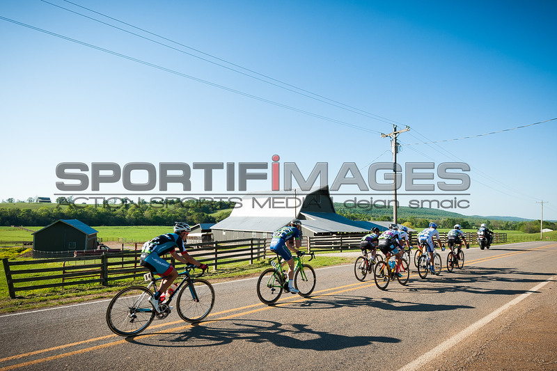 Joe Martin Stage Race. Stage 3. UCI Pro 1 Men.  A breakaway during the final 25 km of the race passes some local scenery during late afternoon sun.
