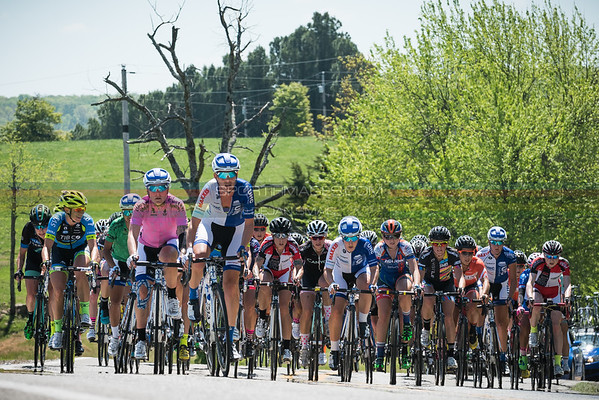 Joe Martin Stage Race Pro 12 Women Stage 3. The womens field powers their way up a short climb with agressive racing up to this point.