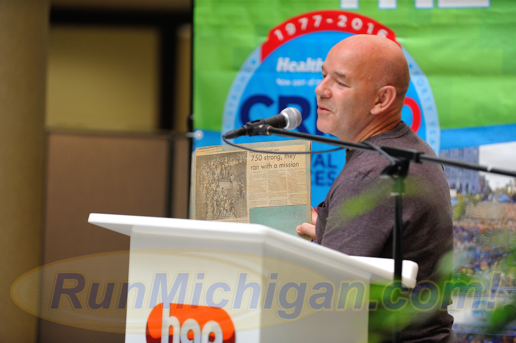 Bolton, England's Steve Kenyon, overall winner of the first ever Crim 10 Mile Race in 1977, shares a 1977 race news story at the 2016 Crim Festival of Races pre-race press event on August 24, 2016 in Flint Twp., Michigan. (Photos: RunMichigan.com)
