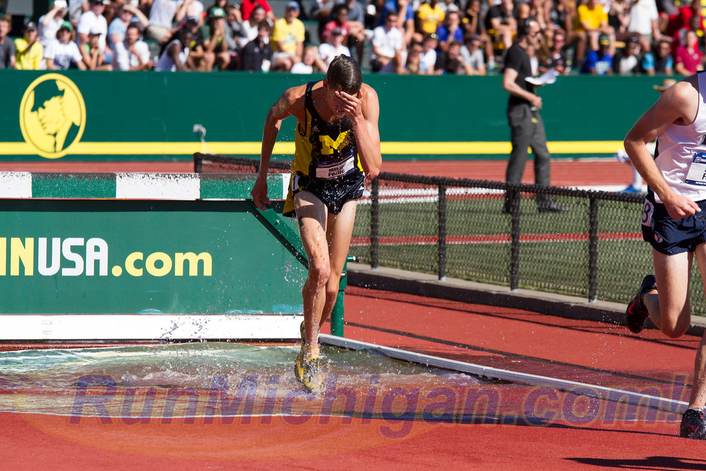 One year before capturing the 2016 NCAA D1 Outdoor T&F Steeplechase National Title, Mason Ferlic gained some fame for a different reason, taking a spectacular fall at the 2015 NCAA's. Ferlic would get up to finish and use that as motivation to an incredible 2016 season. (Photo by Michael Lahner/RunMichigan.com)