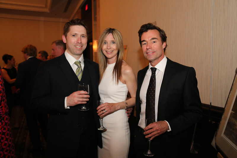 Michael Connors, BA'98, Rebecca Connors, and Don Forestell