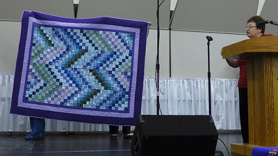 Melba Lacy showing us a Bonnie Hunter scrappy bargello.  see next photo for more information.