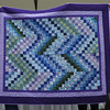 This bargello quilt was made by Melba Lacey.  Melba attended the Bonnie Hunter Scrappy Bargello class.  The fabric was donated by Pam Henry's and was also quilted by Everlasting Stitches.  The purple was from Melba's stash.