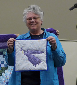 Barb Obst showing us her first Angel Quilt.