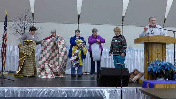 Jan Waligorski, Fran Mort, Jan Gagliano and Jan Lee Asmann with quilt donations.