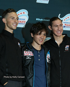 The top three men pose for photos after the short program: Adam Rippon (2nd), Shoma Uno (1st), Jason Brown (3rd)