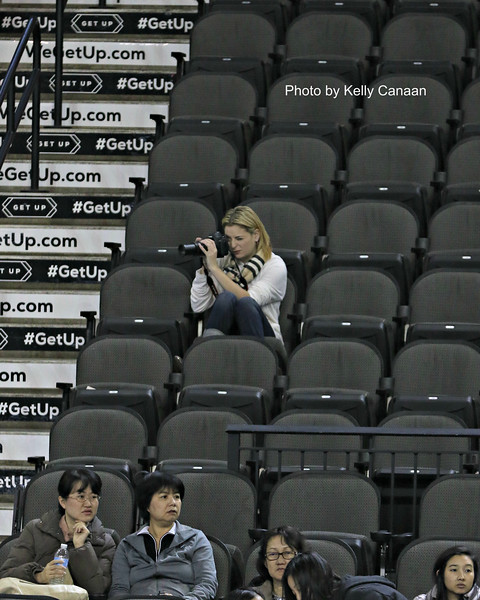 Twin sister (and aspiring photographer) Carly Gold takes photos of Gracie's practice session before the free skate.