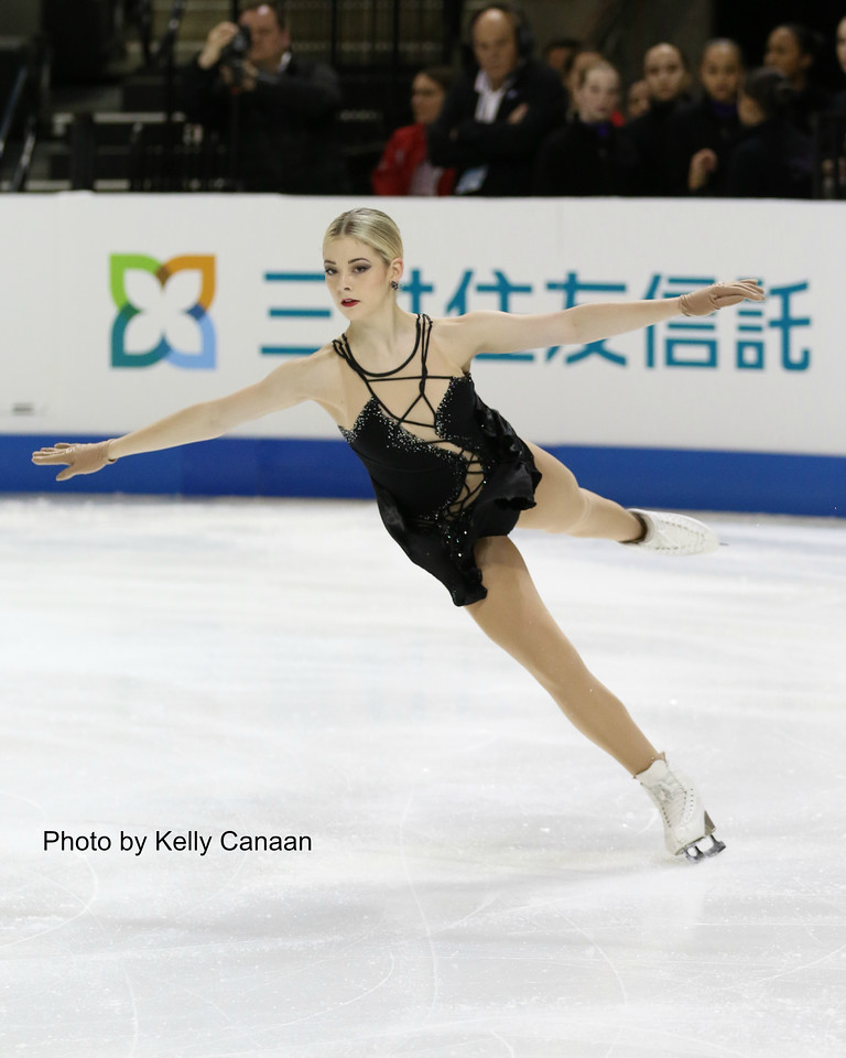 Gracie Gold lands a jump during the warm-up for the short program at Skate America in Hoffman Estates, IL