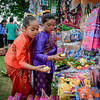 From left, Jvet Suggs, 10, and Anyada Malakham, 10, both of Lowell check out some toys being sold at the Southeast Asian Water Festival in Lowell. SUN/Caley McGuane