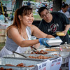 Aorrie Srijor of Thailand hands out traditional food at the Southeast Asian Water Festival in Lowell on Saturday. SUN/Caley McGuane