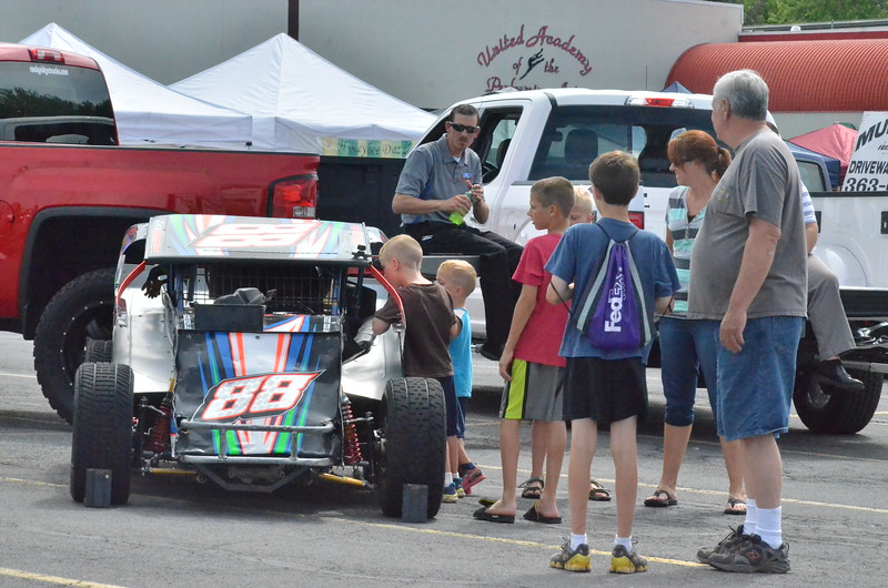 Leah McDonald - Oneida Daily Dispatch Families explore an assortment of vehicles at this year's Touch a Truck event at the Glenwood Plaza in Oneida on Monday, July 11, 2016.