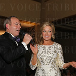 Auctioneer  Bill  Menish and emcee Karen Roby.