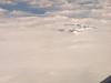 Mountains peeking through the clouds