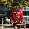Shane Thomas crosses the finish line of the ninth annnual Verne E. Roy Memorial 5K Run/Walk at the Fitchburg Fire Department on Saturday morning. Proceeds from the race are to benefit the Sam Pawlak playground. SENTINEL & ENTERPRISE / Ashley Green