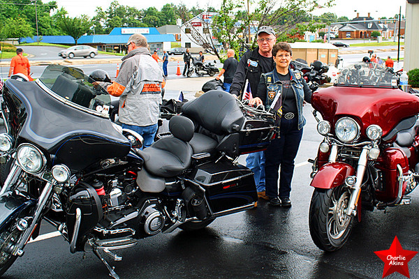 Couple with their impressive Harleys