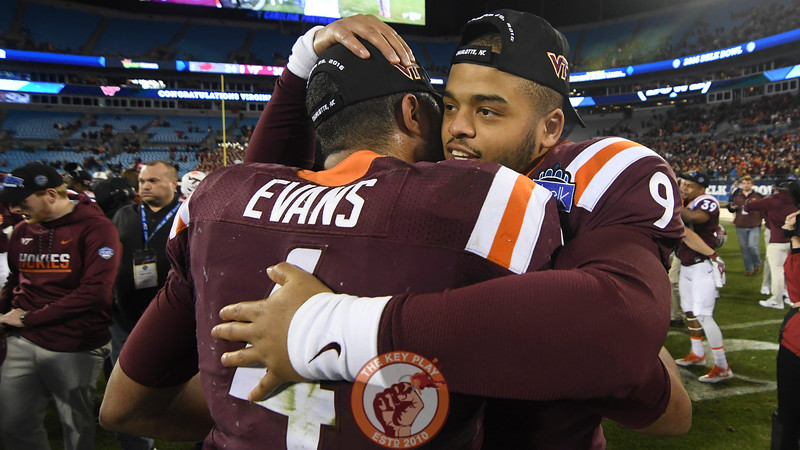 Virginia Tech quarterback Jerod Evans (4) receives a hug from his backup quarterback Brenden Motley (9) following the game. (Michael Shroyer/ TheKeyPlay.com)