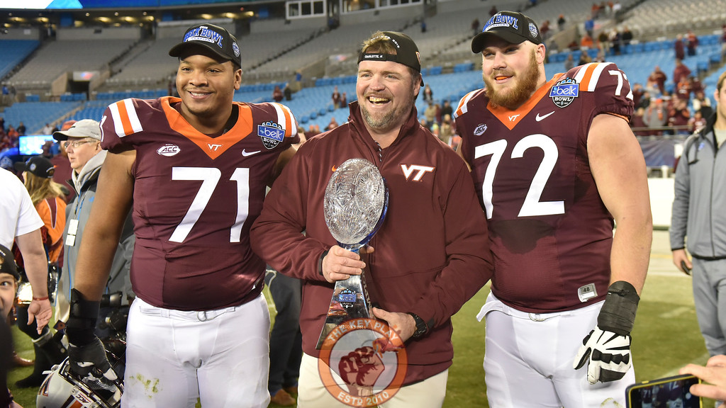 Virginia Tech offensive line coach Vance Vice poses with two of his senior offensive lineman, Jonathan McLaughlin (71) and Augie Conte (72). (Michael Shroyer/ TheKeyPlay.com)