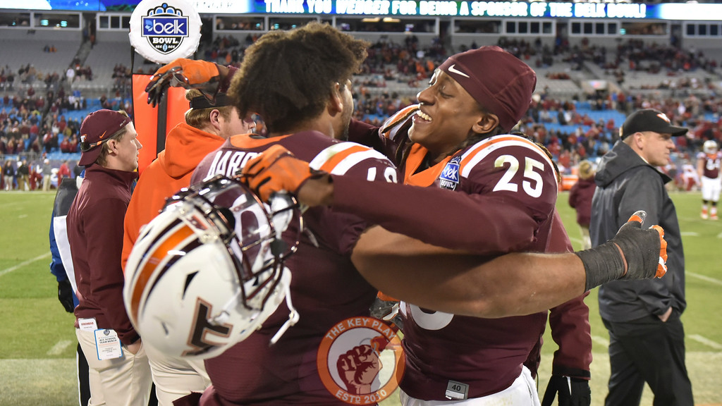 Virginia Tech rover Terrell Edmunds (22) and defensive tackle Woody Baron (60) hug as the final minute ticks down. (Michael Shroyer/ TheKeyPlay.com)