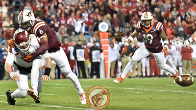 Virginia Tech safety Mook Reynolds (6) hits Arkansas quarterback Austin Allen (8) as he throws the ball down resulting in an intentional grounding penalty. (Michael Shroyer/ TheKeyPlay.com)