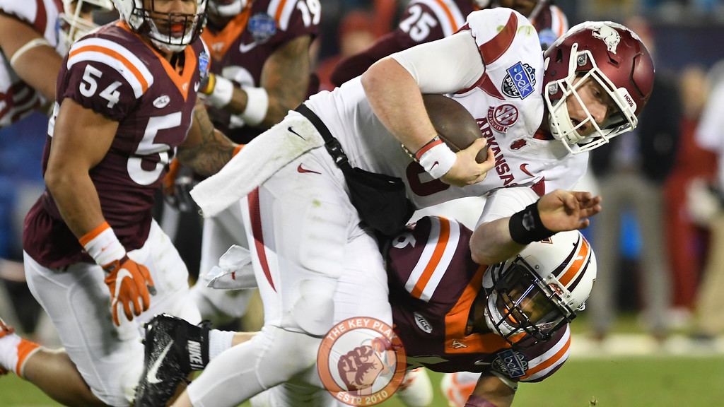 Virginia Tech safety Mook Reynolds (6) hits Arkansas quarterback Austin Allen (8) in the fourth quarter. (Michael Shroyer/ TheKeyPlay.com)
