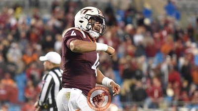 Virginia Tech quarterback Jerod Evans (4) pounds his chest after his second rushing touchdown of the game to increase the Hokies' lead to 35-24. (Michael Shroyer/ TheKeyPlay.com)