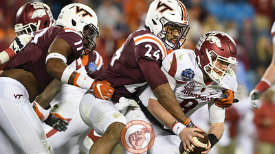 Virginia Tech linebacker Anthony Shegog (24) sacks Arkansas quarterback Austin Allen (8) for a big loss during the fourth quarter. (Michael Shroyer/ TheKeyPlay.com)