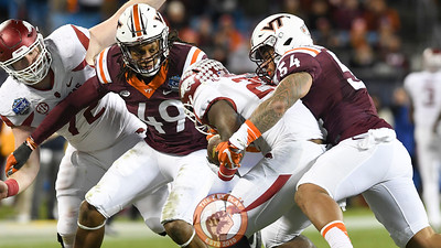Virginia Tech linebackers Andrew Motuapuaka (54) and Tremaine Edmunds (49) bring down Arkansas running back Rawleigh Williams III (22) in the first half. (Michael Shroyer/ TheKeyPlay.com)