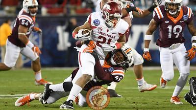 Virginia Tech linebacker Tremaine Edmunds (49) brings down Arkansas running back Devwah Whaley (21) in the first half. (Michael Shroyer/ TheKeyPlay.com)