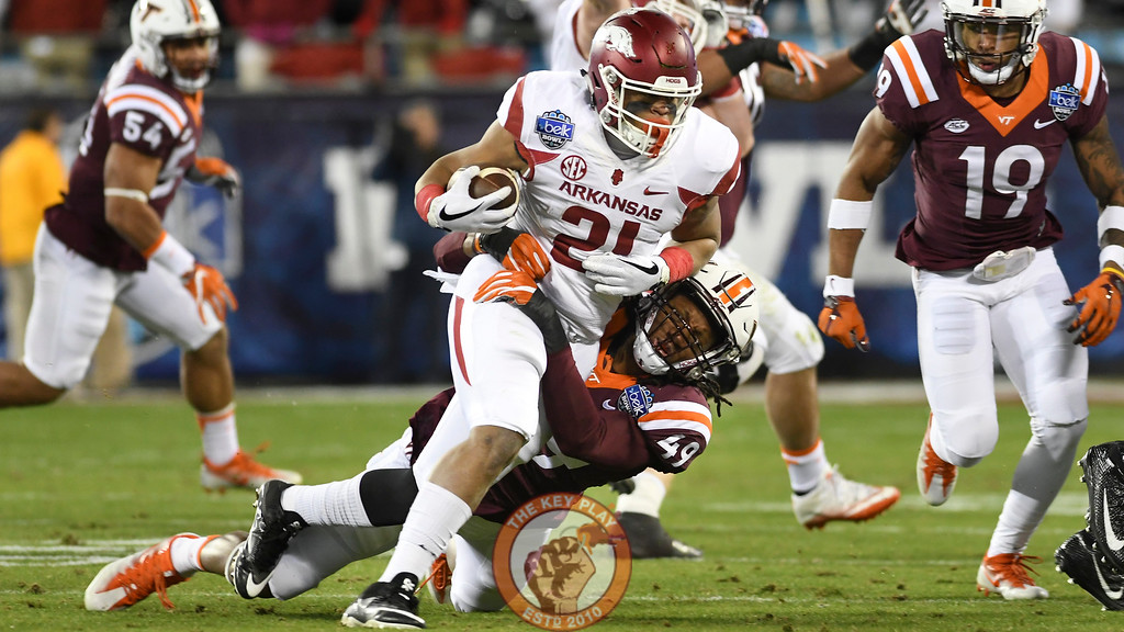Virginia Tech linebacker Tremaine Edmunds (49) brings down Arkansas running back Devwah Whaley (21) in the first half. (Michael Shroyer/ TheKeyPlay.com)