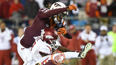 Virginia Tech rover Terrell Edmunds (25) avoids the initial targeting penalty with a legal hit on Arkansas wide receiver Dominique Reed (3). (Michael Shroyer/ TheKeyPlay.com)