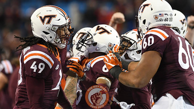 Virginia Tech linebacker Tremaine Edmunds (49) celebrates with teammates following his interception. (Michael Shroyer/ TheKeyPlay.com)
