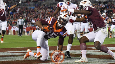 Virginia Tech tight end Chris Cunningham (85) is met following his touchdown reception by wide receiver Cam Phillips (5). (Michael Shroyer/ TheKeyPlay.com)