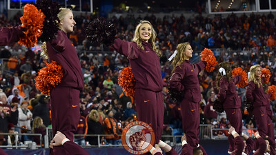 Members of the Virginia Tech Hokies cheerleading squad perform during the game against the Arkansas Razorbacks. (Michael Shroyer/ TheKeyPlay.com)