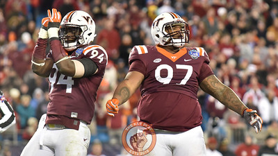 Virginia Tech defensive tackle Tim Settle (97) and defensive end Trevon Hill (94) react during the fourth quarter with all the momentum on the Hokies' side. (Michael Shroyer/ TheKeyPlay.com)