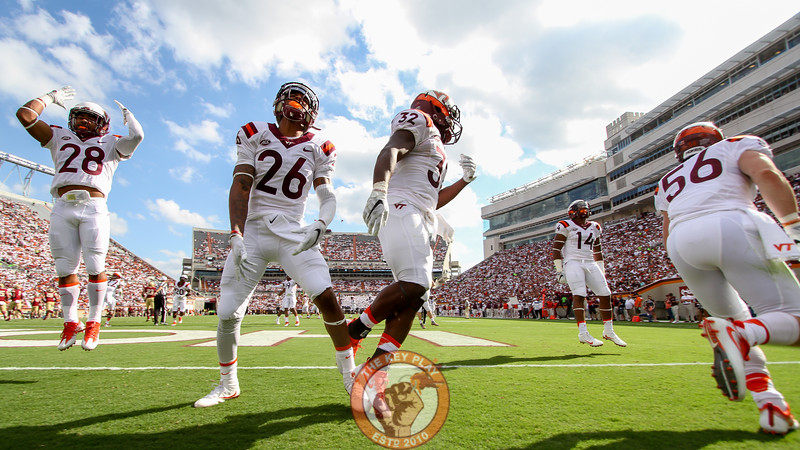 The Hokies' special teams unit runs through the back of the endzone on a touchback to pump up the crowd. (Mark Umansky/TheKeyPlay.com)