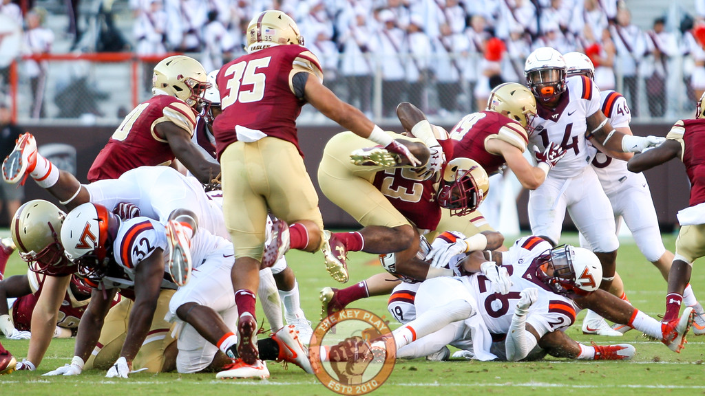 Boston College RB Myles Willis (23) is upended by the Hokies on a short run. (Mark Umansky/TheKeyPlay.com)