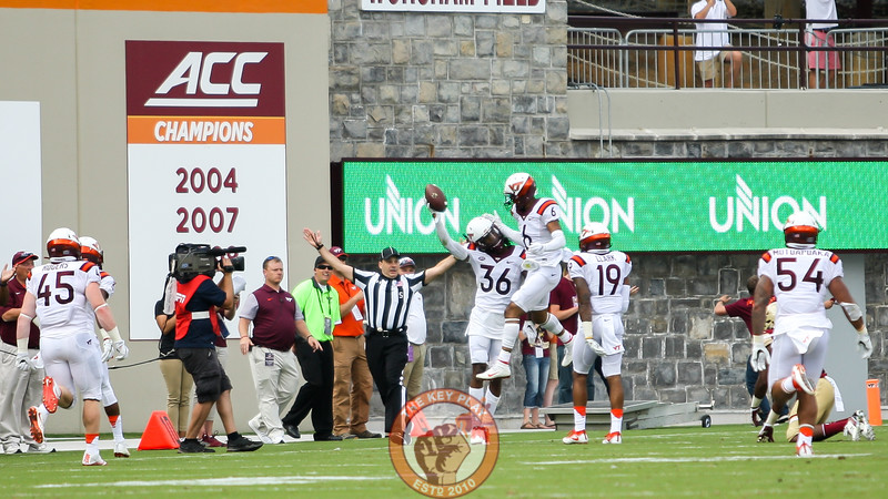 Adonis Alexander (36) holds up the ball after intercepting a Boston College throw late in the first half. (Mark Umansky/TheKeyPlay.com)